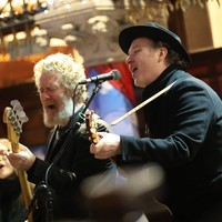 Watch: Glen Hansard and Imelda May among dozens taking part in Christmas Eve busk in Dublin