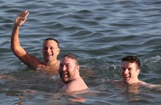 Taoiseach among dozens taking the dive at the Forty Foot for a festive swim today