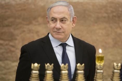 Israeli Prime Minister Benjamin Netanyahu lighting a Hanukkah candle at the Western Wall.
