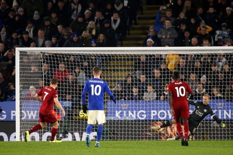 Pay the penalty: Milner tucked away the spot kick to put Liverpool 2-0 up.