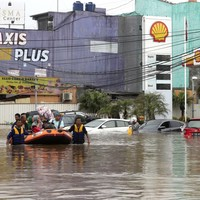 9 people dead as New Year revellers caught in flooding in Indonesia's capital