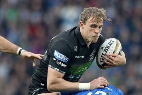 Jonny Gray of Glasgow Warriors is tackled by Leinster's Garry Ringrose.