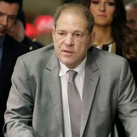 Harvey Weinstein threatened with jail after using his phone in court