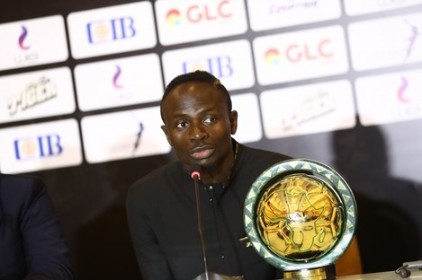 Senegalese football player Sadio Mane speaks after receiving the Player of the Year award during the 28th Confederation of African Football (CAF) Awards in Hurghada, Egypt.