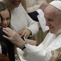 'Don't bite!' Pope negotiates papal kiss from nun after hand-slapping controversy