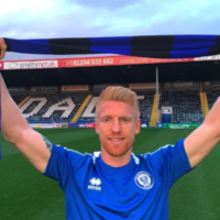 Paul McShane signs new long-term contract with Rochdale