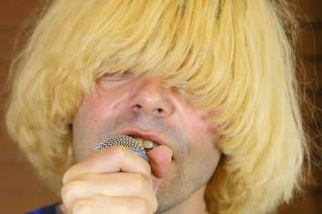 Charlatans frontman Tim Burgess performing at the Isle of Wight festival