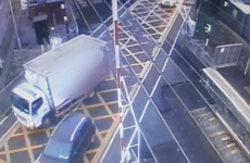 'Major delays' expected as truck driver damages level crossing in Sutton