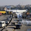 Passenger jet skids from runway on to street in Iran