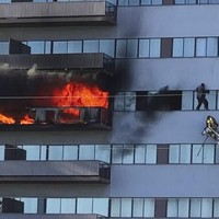 Firefighters rescue man by ladder as he attempts to flee burning high-rise building in LA