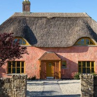 Pretty-in-pink Waterford cottage with a charming thatched roof for €290k