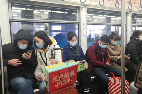 Chinese citizens in Chongqing, China wearing face masks.