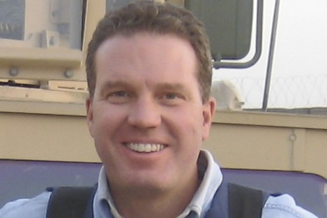 Greg Burke pictured while working in Afghanistan in 2007.