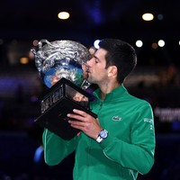 Dizzy, dehydrated Djokovic rallies from brink to win eighth Australian Open