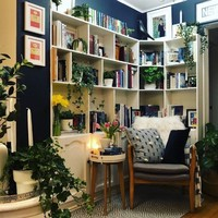 'I painted the walls inky navy to contrast with the shelves': Valerie shares her plant-filled reading nook