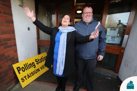 Sinn Fein leader Mary Lou McDonald, with local councillor Seamas McGrattan, arriving to cast her vote at St Joseph's School in Dublin yesterday.