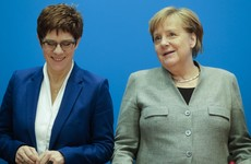 Favourite to replace Angela Merkel stands down amid far right row