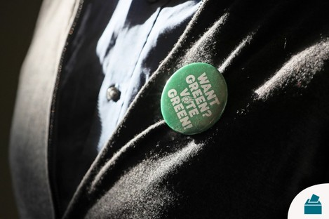 Green Party supporter wearing a badge earlier this month.