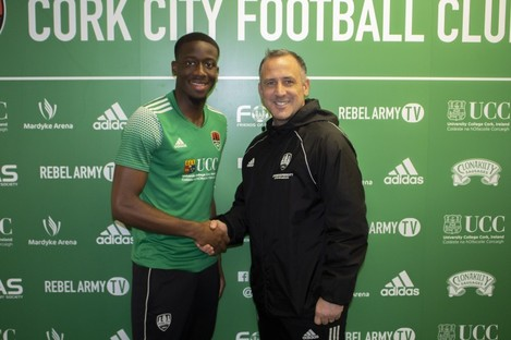 Joseph Olowu and Cork city boss Neale Fenn.