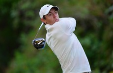 Two eagles puts McIlroy in contention while Woods slips after bright start