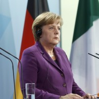 Kenny calls for sharing of bank debts - as Merkel again rules out Eurobonds