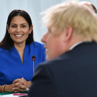 UK unveils new points-based immigration system as Home Secretary is questioned whether her parents would qualify
