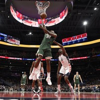 Middleton shines as high-flying Bucks withstand 55-point burst from Wizards' Beal