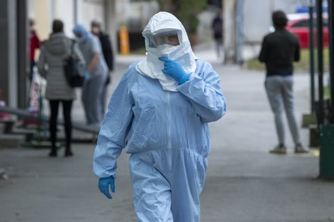 A health worker wears a protective suit at the infectious disease clinic in Zagreb, Croatia.