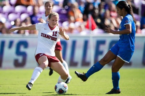 Kyra Carusa (left) pictured competing for Stanford University, where she began her college career.