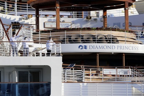 Crews on the deck of the quarantined Diamond Princess cruise ship earlier this month.