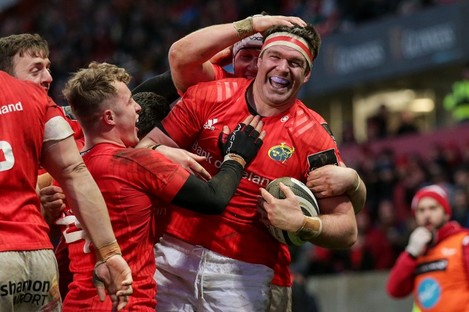 Munster's Billy Holland celebrates his try.