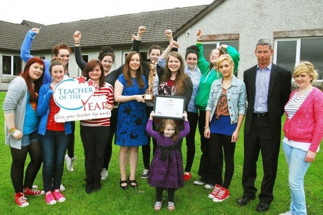 Evelyn O'Connor (in blue holding award) with some of her students