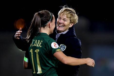 Vera Pauw celebrates with captain Katie McCabe.