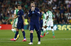 Madrid blow initiative in title race with defeat to Real Betis