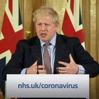 Boris Johnson urges British people to avoid social contact and to work from home