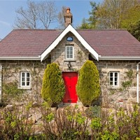 Cottage with character: Renovated gate lodge with three acres of gardens for €225k