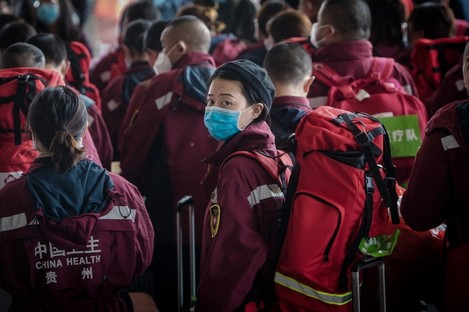 Medical worker Cheng Xiaoxue waits to board a train at the Wuhan Railway Station.
