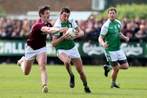 London's Liam Feerick is tackled by Shane Walsh of Galway in the 2019 Connacht SFC.