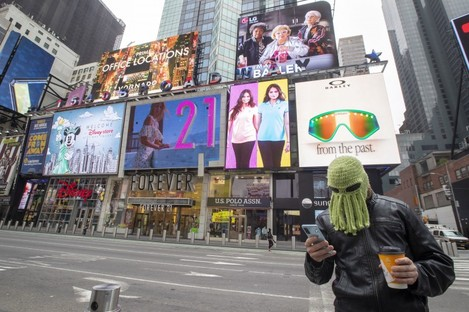 A man wears an octopus hat in New York's Times Square.