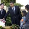 Obama thanks God, pardons two turkeys, eats sweet potato pie