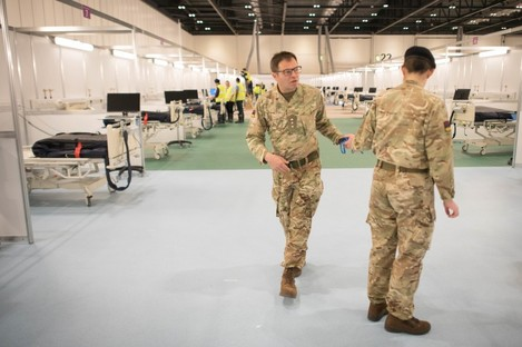 Military personnel at the ExCel centre in London which is being made into a temporary hospital