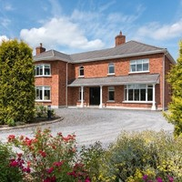 Expansive modern living on one acre of immaculate gardens - yours for €595k