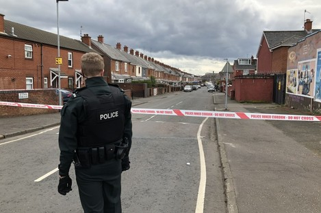 A PSNI police officer at the scene of Robbie Lawlor's killing