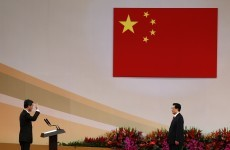 Hong Kong leader heckled on first day in office