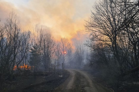 A forest fire burning near the village of Volodymyrivka, in the exclusion zone around the Chernobyl nuclear power plant, earlier in April