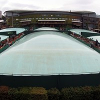 Murray forced to wait as play abandoned at Wimbledon
