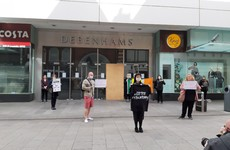 Protesters staging demonstration outside Debenhams store in Dublin are moved on by gardaí