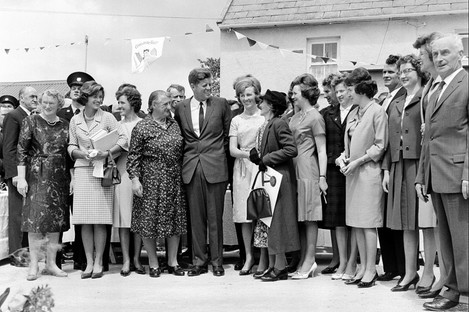 U.S. President John F. Kennedy meets with his Irish cousins in the barnyard of their mutual forefather's homestead, at Dunganstown, June 27, 1963.