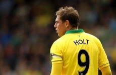 Holt stays at Norwich after inking new deal