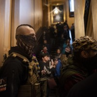 Armed protesters enter Michigan parliament building to demand end to lockdown
